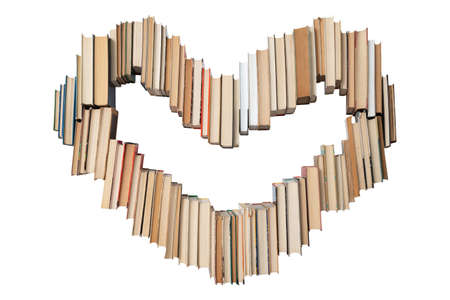 Heart shape made of books isolated on white background. Concept of love and education. Nobody