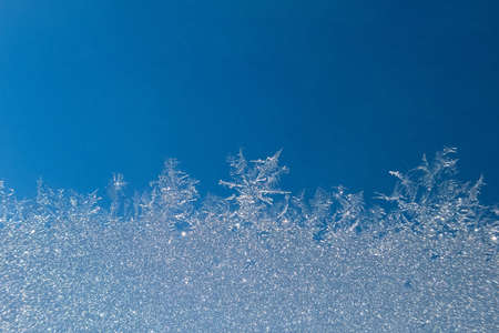 Abstract view of frost on window surface. Blue crystal frost texture. Cold winter background. Nobody 스톡 콘텐츠