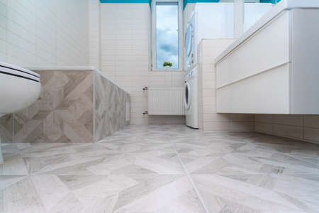 Bathroom after renovation. New stone tiles on the bath room floor. Home renovation and improvement concept. Nobody 스톡 콘텐츠