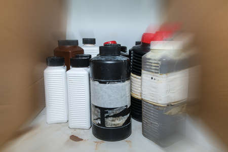 Flammable dangerous chemical in plastic bottle containers on a shelf in the lab