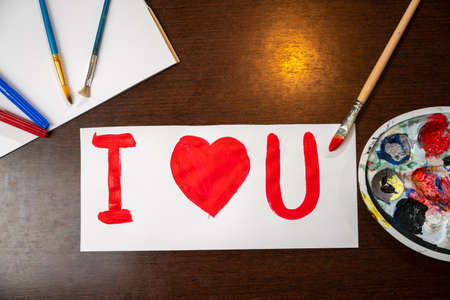 Hand made greeting card for Valentines day. I love you sign painted with paint brush on white paper. Banco de Imagens