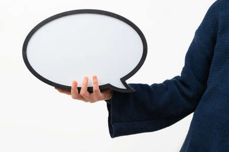 Close up of person holding blank speech bubble on white Banco de Imagens