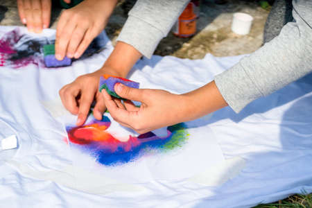 Creating your own t-shirt workshop outside. Banco de Imagens