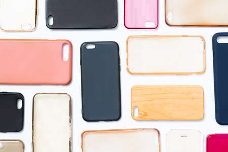 Pile of multicolored plastic back covers for mobile phone. Choice of smart phone protector accessories on white background. A lot of silicone phone backs or skins next to each other Stock fotó