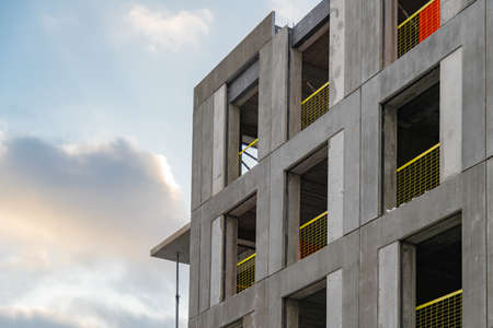 Structure of an apartment block at construction site. Housing development project.