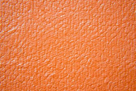 Close up of orange leather texture. Grunge skin fabric background. Banco de Imagens