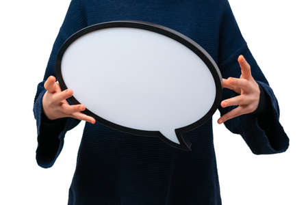 Close up of person holding blank speech bubble on white background. Communication and dialogue.
