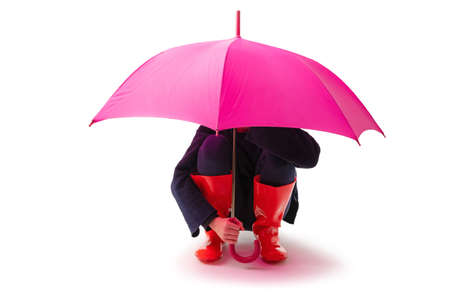 Person wearing red rubber shoes and rain umbrella isolated on white background.