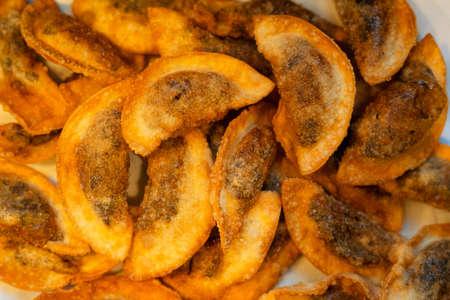 Fried gyoza dumplings with mushroom filling. Golden crunchy dumplings cooked in a pan.