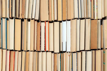 Vintage book background. Old and used hardback books stacked next to each other. Concept of education and studying. Nobody Banque d'images