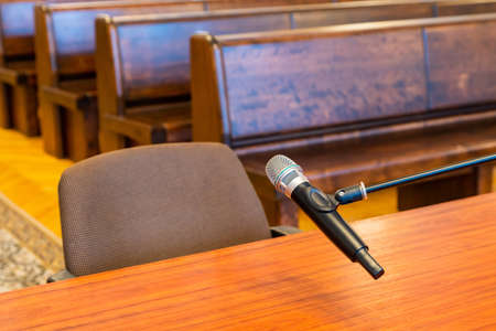 Closeup of microphone in the courthouse. Justice system, witness testimony. Nobody Banque d'images