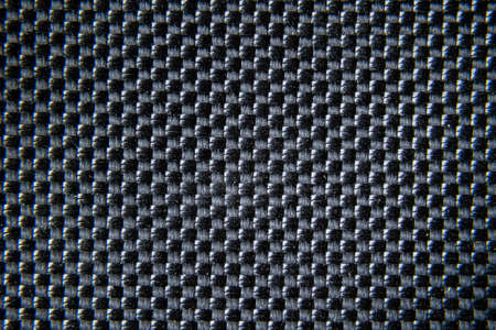 Close up of carbon fiber textile texture. Very strong fabric background