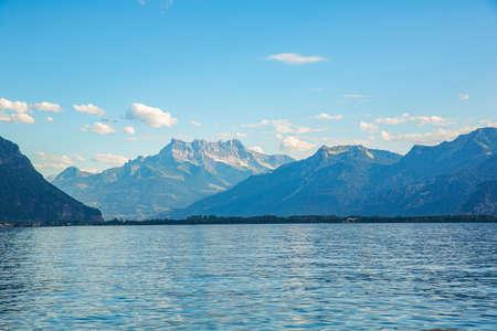 Lake Geneva peaceful panorama, water surface and Swiss Alps on horizon