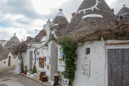 Famous touristic walking path in Alberobello trulli town with souvenir shops
