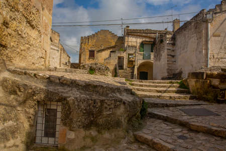 Peaceful alley, traditional ancient stone house in Matera Old Town 版權商用圖片