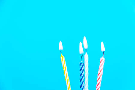 christmas cake: Beautiful colour candles on blue background. Candles for party.