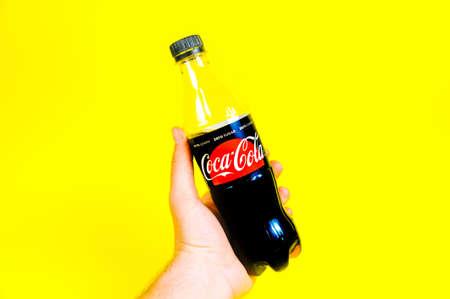 Man holding Coca Cola. Cola zero sugar. Coca cola no sugar.