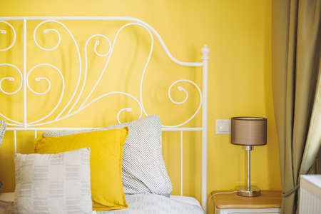 Close up photo of cute yellow bedroom