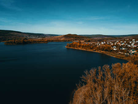 Aerial drone shot of beautiful lake and village