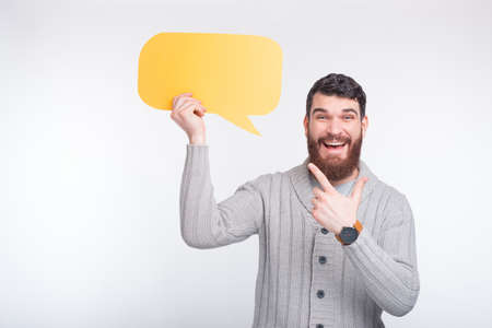 Look whats said here Cheerful man is pointing at the yellow bubble speech he is holding
