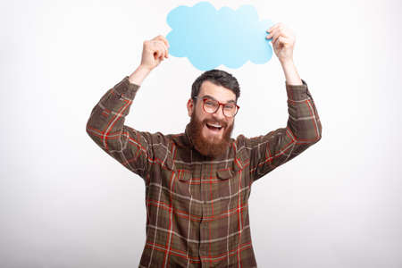 happy bearded man in glasses holding cloud above his head Imagens
