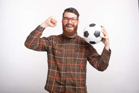 My team have won. Bearded man is holding a ball and making the winner gesture.