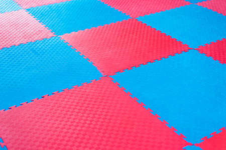 Photo background of blue and red tatami sport for martial arts