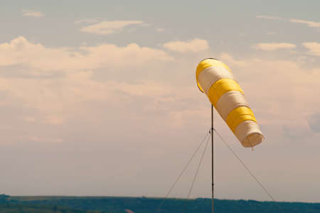 Photo of windsock indicator of wind on runway airport