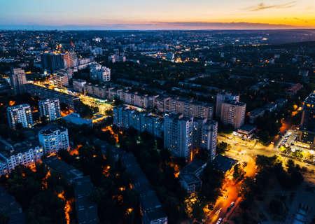 Photo of beautiful city after sunset, city lights, grainy photo