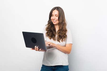 Female student enjoys using her new laptop for work or study.