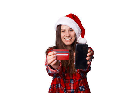 Woman wearing a plaid shirt is showing at the camera the card she has got and phone screen. Standard-Bild