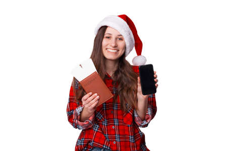 Pretty young woman has got a notification about a trip for Christmas.
