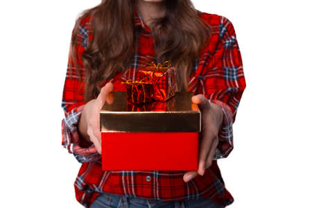 Young woman is holding some gift boxes. Photo with no face.