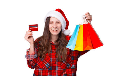 Wide smiling girl is holding some shopping bags she bought for Christmas. Standard-Bild