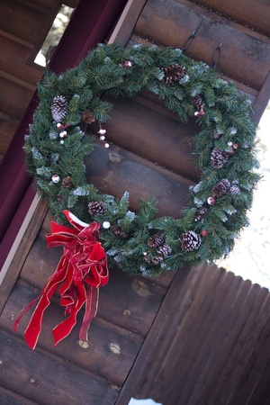 Wreath on a wooden building photo