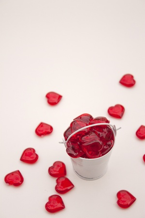 Heart shaped pieces in small white metal bucket for Valentine s Day