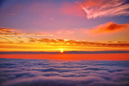 sunset above clouds photo