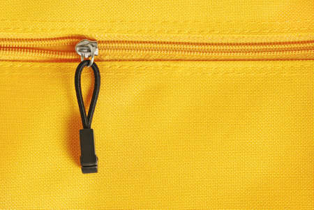 zipper on yellow textile material photo
