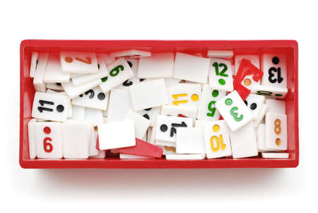 rummy: rummy pieces in box on white