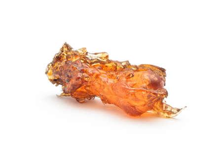 rosin: raw amber stone on white Stock Photo