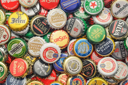 caps: CARANSEBES, ROMANIA - JULY 6, 2014: Background of beer bottle caps, a mix of various european brands.