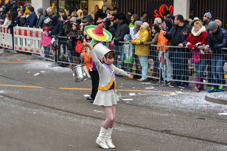 fasching: Karlsruhe, Baden Wuerttemberg, Germany - February 16, 2015: The 300th anniversary of the city of Karlsruhe, annual Carnival and parade, Fasching. Girl doing the baton twirling.