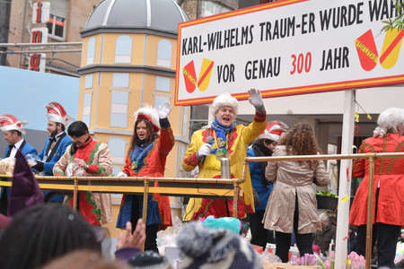fasching: Karlsruhe, Baden Wuerttemberg, Germany - February 16, 2015: The 300th anniversary of the city of Karlsruhe, annual Carnival and parade, Fasching. Men in carnival suit saluting the crowd.