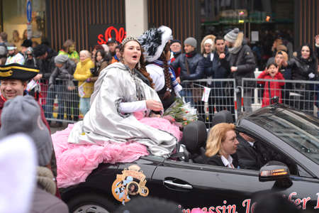 fasching: Karlsruhe, Baden Wuerttemberg, Germany - February 16, 2015: The 300th anniversary of the city of Karlsruhe, annual Carnival and parade, Fasching. Girls in carnival costumes saluting the crowd from a car.
