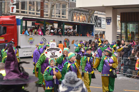 fasching: Karlsruhe, Baden Wuerttemberg, Germany - February 16, 2015: The 300th anniversary of the city of Karlsruhe, annual Carnival and parade, Fasching. Group of people in carnival costumes.