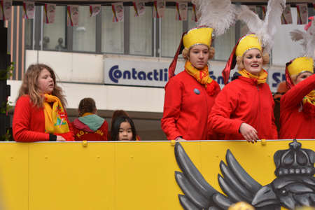 fasching: Karlsruhe, Baden Wuerttemberg, Germany - February 16, 2015: The 300th anniversary of the city of Karlsruhe, annual Carnival and parade, Fasching. Gilrs having different feelings about the parade. Editorial