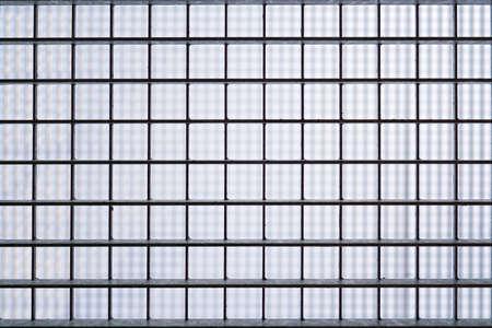 iron barred: iron barred prison window grill Stock Photo