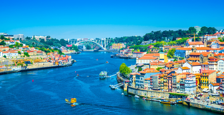 Beautiful panoramic view over Dom Luis I bridge and traditional boats on Rio Douro river in Porto, Portugal Stok Fotoğraf - 95893453