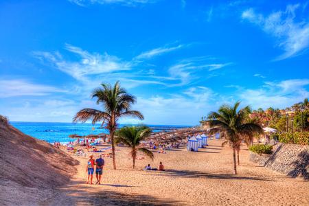 People on El Duque beach enjoying summer holiday on Adeje coast in Tenerife, Canary island of Spain 스톡 콘텐츠