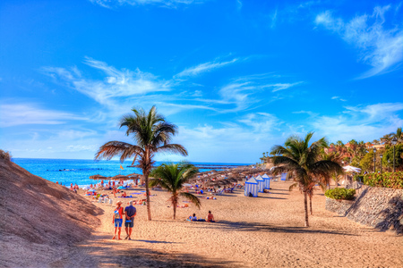 People on El Duque beach enjoying summer holiday on Adeje coast in Tenerife, Canary island of Spain Archivio Fotografico